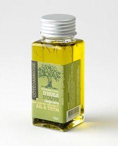 Préparation à base d'huile d'olive vierge extra  à l'ail et au thym