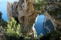 Walking the Arco Naturale Footpath on Capri    You'll need good shoes and plenty of stamina to cope with the 800-odd steps, but will be rewarded by some of the most spectacular scenery to be found in the region.    Photo Caption: The Arco Naturale in Capri, Italy.    Photo by logicalrealist/Flickr.com
