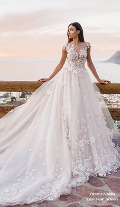 """Wedding Dresses Lace Keyhole 21 Oksana Mukha Wedding Dresses 2019 Oksana Mukha wedding dresses 2019 will take your breath away. A wedding collection called """"The Sea of Senses"""" shows romantic luxurious wedding dresses. Luxury Wedding Dress, Modest Wedding Dresses, Bridal Dresses, Wedding Gowns, Wedding Bride, 20s Wedding, Cream Wedding, Paris Wedding, Sparkle Wedding"""