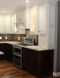 "Rich dark base #cabinets in a ""Mocha"" stain paired with #painted ""Pearl"" wall cabinets.    