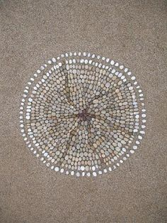 Sue Lawty's pebble mandala. / Basic shapes. A circle has been a holy symbol in many cultures.