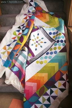 Stunning round robin quilt made by Meghan Eschbaugh. Contributed to by members of the Indianapolis Modern Quilt Guild. Using Vanessa Hutchinson's ombre fabrics.