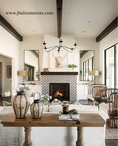 See source for the living room decor, such as chandelier on Home Bunch