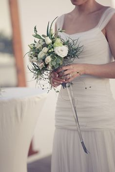 White and green wedding bouquet with ribbon detail