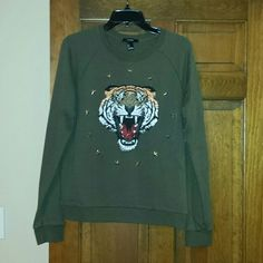 Tiger sweatshirt Green crewneck sweatshirt with graphic tiger on front surrounded by silver studded stars. Exc condition, looks like new! Forever 21 Tops Sweatshirts & Hoodies