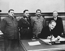September 4, 1944 - Finland and the Soviet Union agree to a cease-fire. The Soviet leadership signed a treaty with the Finnish Democratic Republic. Standing, from left to right are Andrei Zhdanov, Klim Voroshilov, Stalin, and Otto Kuusinen. Seated is Vyacheslav Molotov.