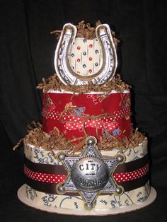Cowboy Baby Shower Diaper Cake: This cake is made with 66 pampers swaddlers, a baby bottle, 3 custom burps and 2 Christmas ornaments. Cowboy Diaper Cakes, Diaper Bag Cake, Cowboy Baby Shower, Baby Boy Shower, Baby Shower Gifts, Baby Showers, Cute Baby Shower Ideas, Baby Shower Themes, Baby Shower Desserts