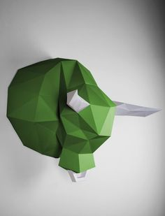 The imposing bull in the low poly design is an impressive accent to your wall with its green color and white horns and the white nose ring. #Papertrophy