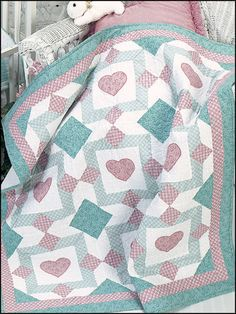 "Soft pastel colors are used to make this pretty baby quilt. Size: 42"" x 42"".  Skill Level: Easy"