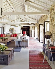 Rustic open-plan living room with exposed beams. Major want.