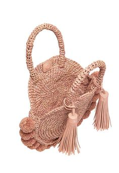 """Round straw tote in ballet raffia with raffia pom poms. Take with you on your next beach escape. - Color: Ballet Raffia - Raffia Pom/Tassels - Double handles - Removable Tassels - Snap closure - Due to the delicate nature of the fiber, fraying may occur is considered normal wear. Avoid contact with water. Measurements: - H- 4.5"""" - D- 2"""" - L- 10"""""""