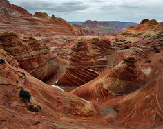 Vermilion Cliffs in Arizona.  They look colorful in the picture, but pictures don't tell you how large and impressive the formations are.