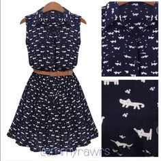 The Emmy Buttoned Cat Print Dress with Belt Have a feline obsession? Then this dress is the perfect dress for you. Features all around cat prints, an elastic waist, buttons from neckline to waist. Will come with belt. Belt is one size. Made of polyester. Color: dress is a deep navy color, cat prints are a cream color. Dresses