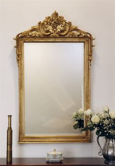A flower basket embraced by lively C-scrolls rests on a bed of laurels atop this French Provincial frame. The beveled mirror and hand-laid antique gold leaf finish perfect the Flower Basket& charming effect. Gold Frame Wall, Frames On Wall, Living Room Decor, Bedroom Decor, Baroque Decor, Luxury Mirror, Beveled Mirror, Bathroom Wall Decor, Flower Basket