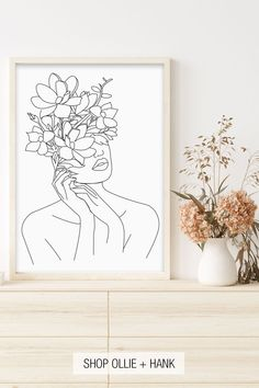 Looking for a minimal flower face line art? Our simple black and white woman with flower head illustration makes a abstract neutral addition to any modern bathroom decor, boho bedroom wall decor or a unique plant lover gift idea. Minimalist feminine wall art available as both printed and printable artwork making it an easy DIY project for boho living room decor on a budget.