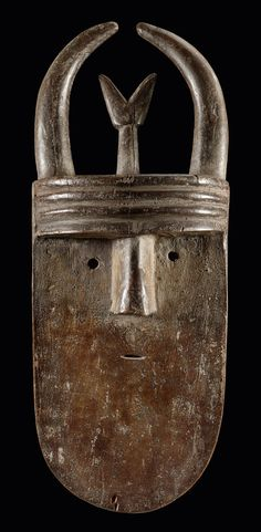 Africa | Angbai mask from the Poro society of the Toma people Guinea and Liberia | Wood