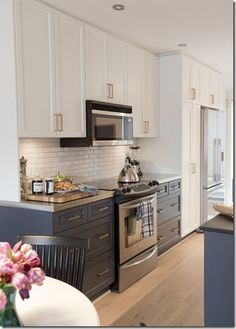 two toned grey and white kitchen.  Less blue and more grey on the lower cabinets with a concrete countertop, please.