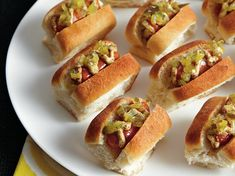 Spicy Mini Dogs - Sausages are sandwiched between dinner rolls for tasty appetizers – ready in 20 minutes.