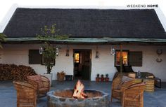 Country house with fire pit and Spanish / Texas Ranch flair - White stucco building exterior Outdoor Rooms, Outdoor Living, Rustic Stone, Building Exterior, Outdoor Fire, Home Living, Rustic Interiors, Architecture, My Dream Home