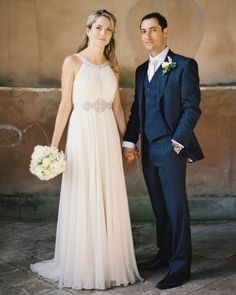 "Jenny Packham's ""Marie Louise"" dress. The groom looks pretty sharp, too! I love the deep navy suit!"