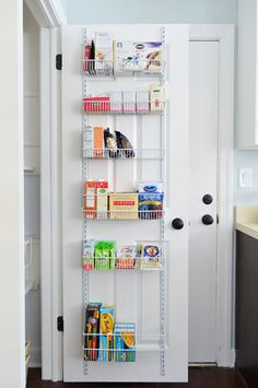 behind the door pantry shelves, $35. can hook over the top of the door or be installed directly on the back of the door.