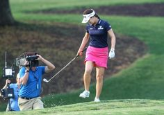 So-Yeon Ryu uses her club to knock sand from the bottom of her shoe during the final round of the LPGA Tour's Kingsmill Championship golf tournament on Sunday, May 17, 2015, in Williamsburg, Va. (AP Photo/Jason Hirschfeld)