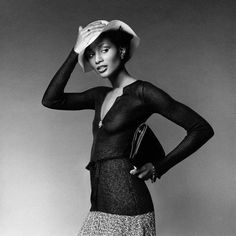 Beverly Johnson photographed in 1974 by Francesco Scavullo in a tweed sweater suit and matching flared skirt and sheer ribbed pullover by African-American designer Scott Barrie (1941-1993).