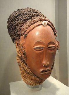 Female mask (Mwana Pwo), Democratic Republic of Congo, Chokwe people, 20th century, wood, paint, fiber, metal - De Young Museum - DSC01078.JPG