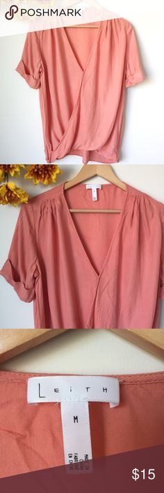 "Leith Flowy Top Size Medium Great condition. Overlapping front. Flowy material and cuffed sleeves. Plunging v-neck. Size Medium. Length 25"" (front), 27.5"" (back). Bust 23"". Color is coral Leith Tops Blouses"