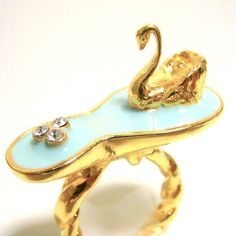 Swan Lake Ring: Available in gold or silver plate with white or aqua lake.