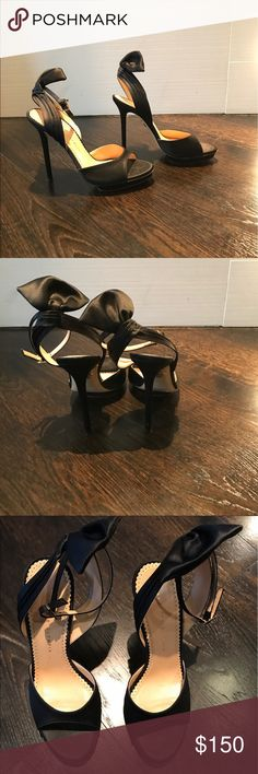 Charlotte Olympia Sandals Charlotte Olympia sandals. Silk satin with beautiful turban design in the back. Size 37 . 4 inch heels with 1 inch platform . Few scuffs and I have included detail photos . Charlotte Olympia Shoes Heels