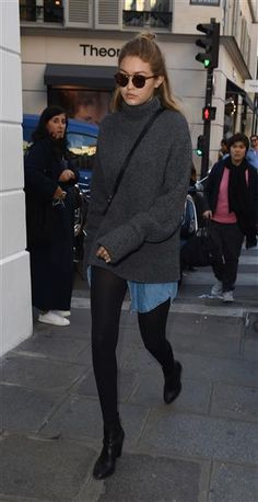Despite skipping pants, somehow this ensemble that Gigi Hadid wore in Paris is still totally on point. The supermodel sported tights under a long denim blouse and topped the look with a cozy gray turtleneck sweater while leaving the Colette store on Oct. 2, 2015.