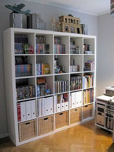 10 Organizing Tips From Chez Larsson Yes! Expedit-like dvd storage that doesn't look like crap! Expedit-like dvd storage that doesn't look like crap! Bookshelf Organization, Home Office Organization, Organization Hacks, Organizing Tips, Organize Bookshelf, Office Storage, Organising, Office Desk, Ikea Expedit Bookcase