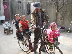 Every morning this foster grandpa takes the boys to school and Jenna tags along for the ride in rural in Anhui province.