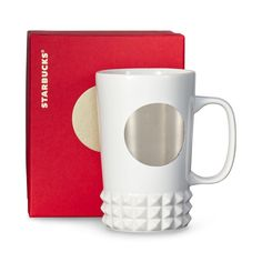 A  ceramic coffee mug with a studded design around the base. Part of our Dot Collection.