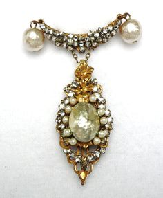 Vintage Miriam Haskell Pearl and Rhinestone Brooch. K. another Miriam Haskell piece.  B.