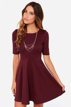 """Classics like the Black Swan Ocean Burgundy Skater Dress never go out of style, and there's a reason why they stick around! This medium-weight stretch knit dress has a scoop neckline and fitted half sleeves pairing with a darted bodice that expertly frames your curves. A flared skirt expands from the waist for a twirl of a good time. Exposed back zipper. Unlined. Model is 5'8"""" and wearing a size X-Small. 76% Polyester, 19% Rayon, 5% Spandex. Hand Wash Cold. Imported."""