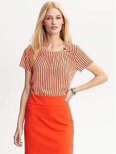 Pretty orange striped silk blouse...perfect to dress up a summer look!