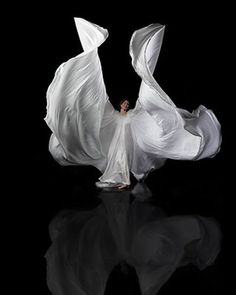 """Chamber Dance Company member Tonya Lockyer flaps her """"wings,"""" which are part of the flowing costumes in Loie Fuller's dances."""