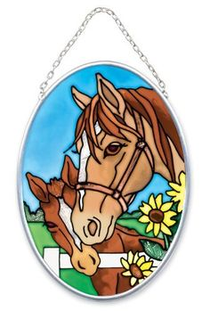 Joan Baker Designs  SO378 Horses Art Glass Suncatcher, 4-1/2-Inch by 3-1/4-Inch by Joan Baker Designs. $12.00. Translucent artwork looks beautiful from inside or outside the window. Hand-painted. Nickle-plated frame and chain for lead free, longlasting beauty. Small in size but big on pretty, these hand-painted art glass Suncatchers perk up any window with a splash of color and appealing design.   For more than 40 years, Joan Baker Designs' talented artisans have cre...