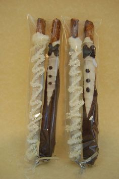 BRIDE and GROOM chocolate covered PRETZEL rods wedding favors bridal shower custom made. $14.00, via Etsy.