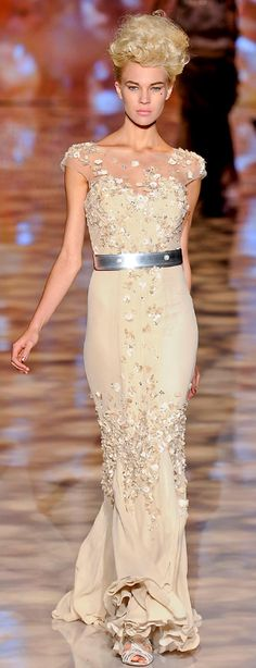 I don't like the belt at all, but the dress is fabulous. Badgley-Mischka-spring-2012...insane