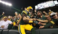 James Jones takes the Lambeau Leap after scoring a 29-yard touchdown against the Seattle Seahawks. Photograph: Raymond Carlin III/USA Today Sports