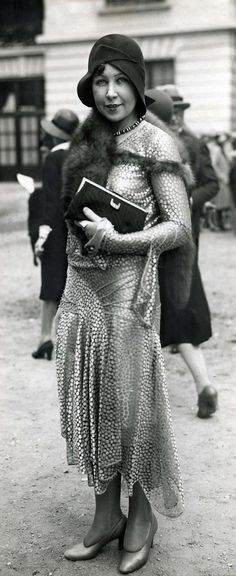 A stylish woman at the Longchamp races in Paris, lovely example of opulent fashion furs. 1929. Had Harris attended ? R or for investigative purposes?