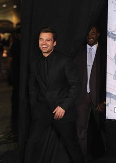 Killing us with that adorable smile.   21 Time Sebastian Stan Was Too Damn Hot (PS love Mackie in the background)