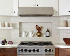 Inset behind range, higher upper cabinets