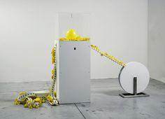YOU KNEW IT AND YOU BLEW IT (2008) - balloons, plexiglas, needle, rubber band, motors, electrical devices, wood, metal - dim. 210 x 170 x 80 cm