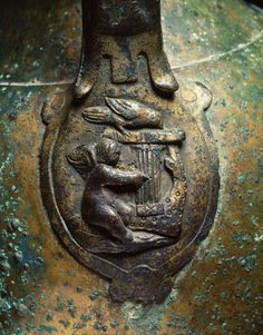 A detail of the Roman bronze vase -  Amor is playing a lyre    23,7 cm, Netherlands    Photo Courtesy: Rijksmuseum van oudheden, Leiden
