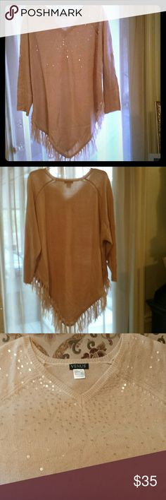 Oversized Fringed Poncho by Venus. Size Medium Pretty, very light pink/champagne colored fringed poncho sweater. It has sequin accents and the sleeves can be rolled up and buttoned to 3/4 length. It's definitely oversized, as is the style. I wore it twice. No sequins are missing, there are no stains or holes. Like new.  Venus Sweaters Shrugs & Ponchos