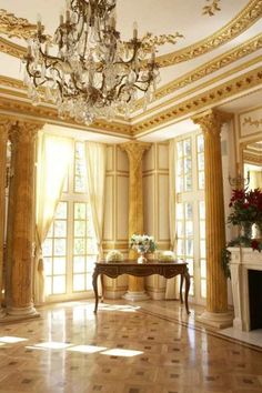 Parisian apartment chic - flooded with light! Beautiful gilt plaster mouldings too above that crystal chandelier